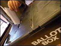 Ballot box hand depositing2