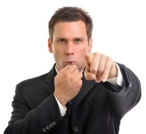 Businessman blowing whistle2_Eric-Hood_iStock