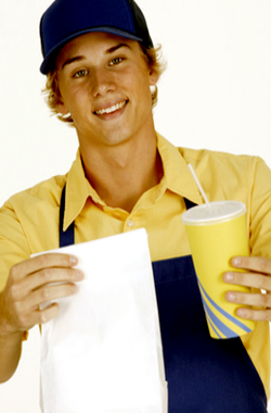 Young man at fast food restaurant