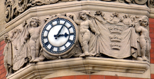 Building clock with four Putti by DH Wright via Flickr creative commons