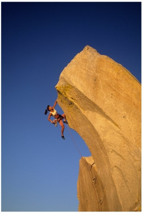Woman climbing cliff via BuyMePosters