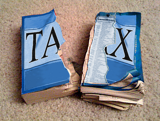 Torn tax code book by Chris Tolworthy via Flickr Creative Commons