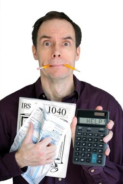 Frustrated taxpayer seeking filing help_by Stephen Uber via iStock