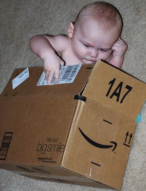 Baby in Amazon delivery box