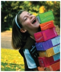 Girl Scout with boxes of cookies courtesy Girl Scouts of the USA