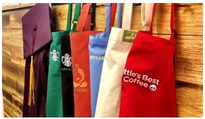 Starbucks aprons and graduation gown