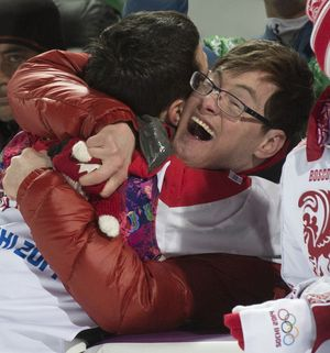 Alexandre Bilodeau and brother Frederic celebrate Sochi 2014 mogul skiing gold medal photo courtesy Canadian Olympic Team