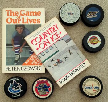Kay Bell hockey book and pucks