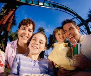 Family at amusement park_485x340