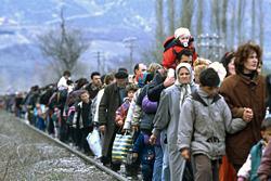 Kosovar refugees fleeing their homeland. Photo by R LeMoyne courtesy United Nations