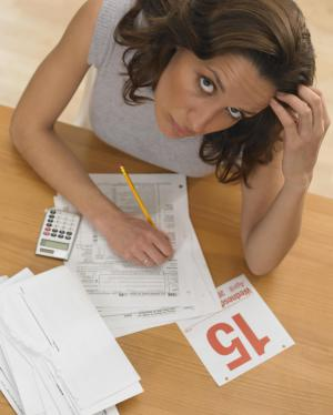 Woman struggling with her tax return_Tetra Images