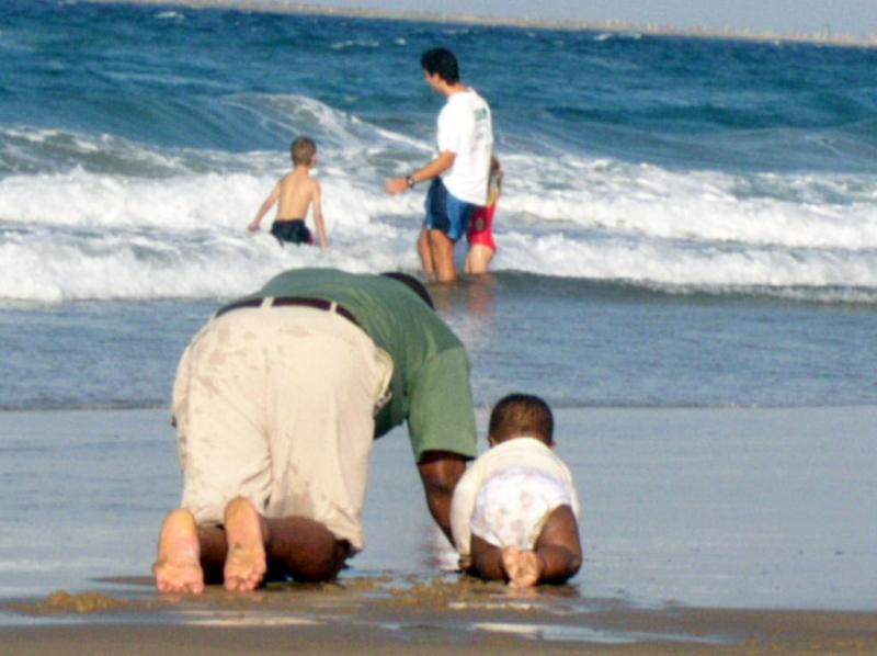 Beachcombing with dad_YoTuT via Flickr