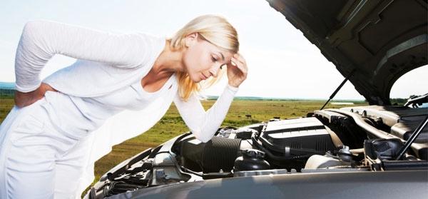Woman-looking-under-hood-of-broken-car_left