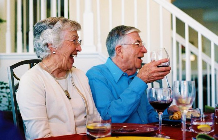 Grandparents at family dinner by Katina Rogers via Flickr