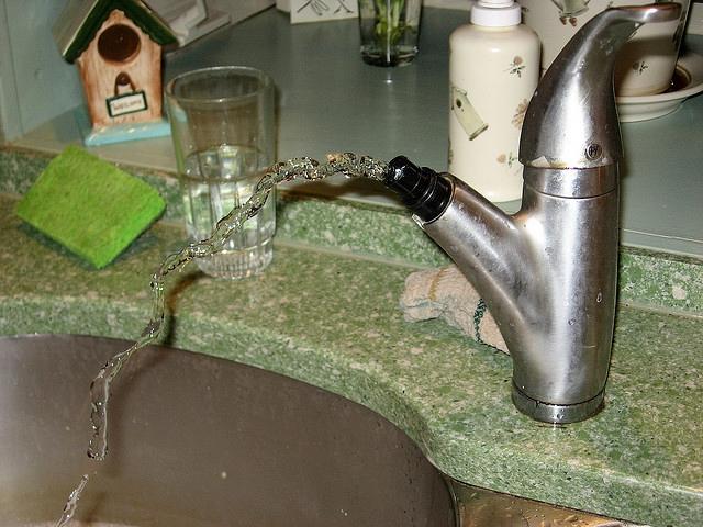Broken kitchen faucet -- not mine! - Julie Zamostny via Flickr