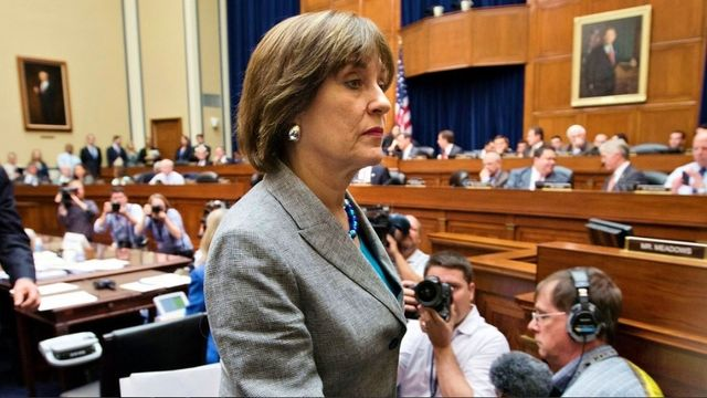 IRS former executive Lois Lerner leaving Congressional hearing