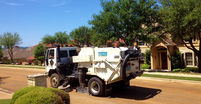 Streetsweeper after neighborhood road resurfacing