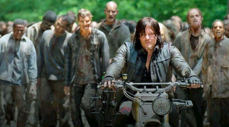 Daryl Dixon leads a zombie horde in The Walking Dead