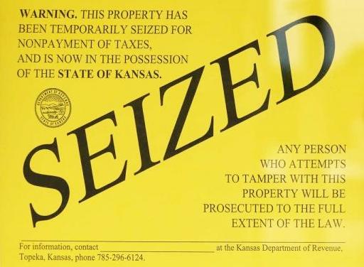 Kansas real property seizure notice