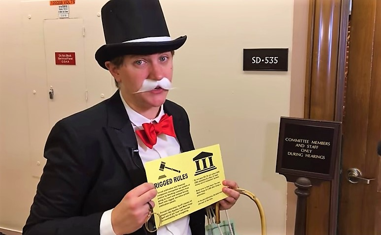 Rich Uncle Pennybags protests at Equifax CEO Senate hearing