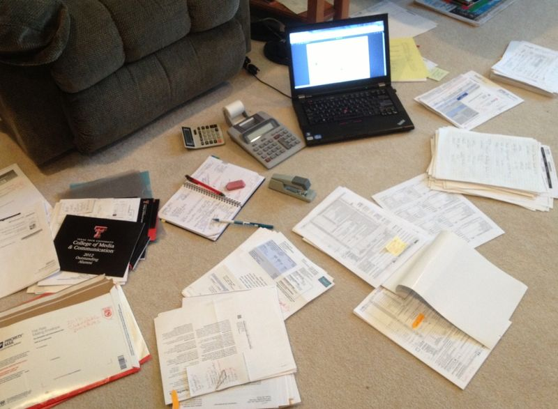 tax filing documents spread out on floor