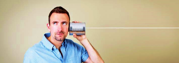 Man-talking-on-tin-can-phone