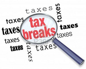 Tax breaks magnifying glass graphic