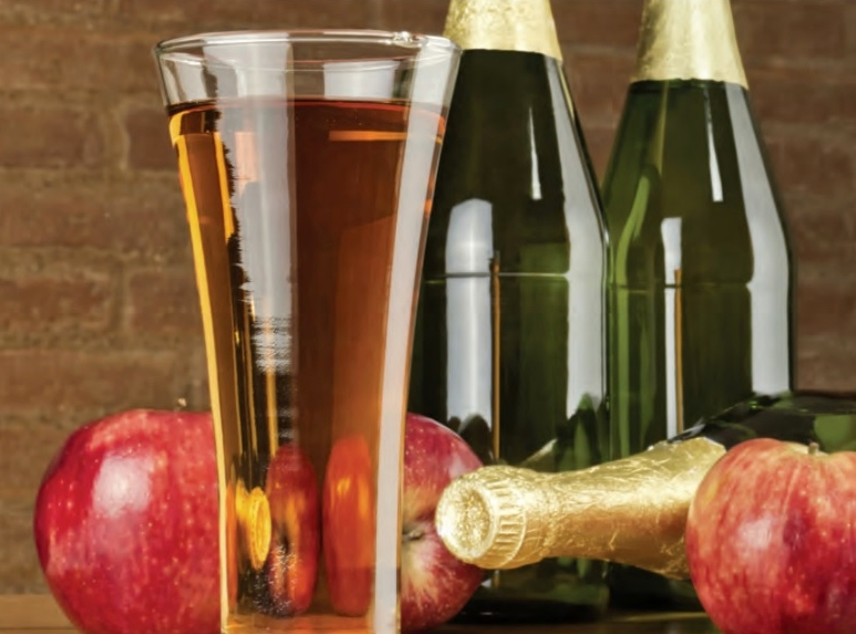 Hard apple cider glass and bottles