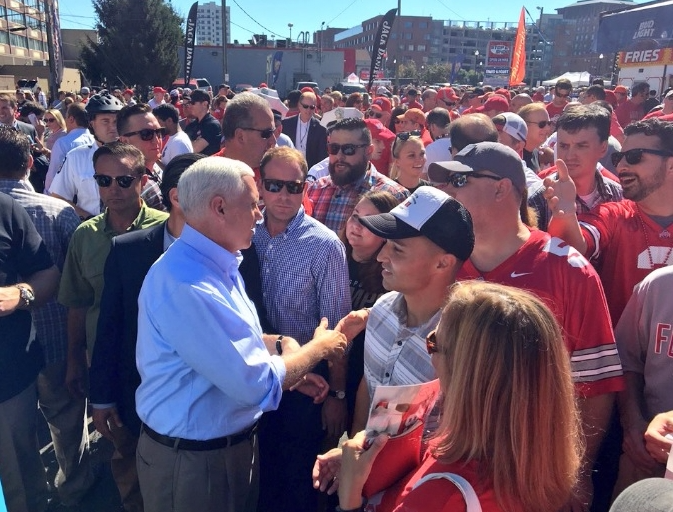 Mike Pence GOP VP candidate greeting Ohio State tailgaters via @mikepence Twitter