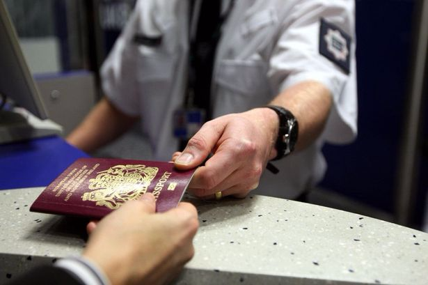 UK border agency check of a passport_Birmingham Mail