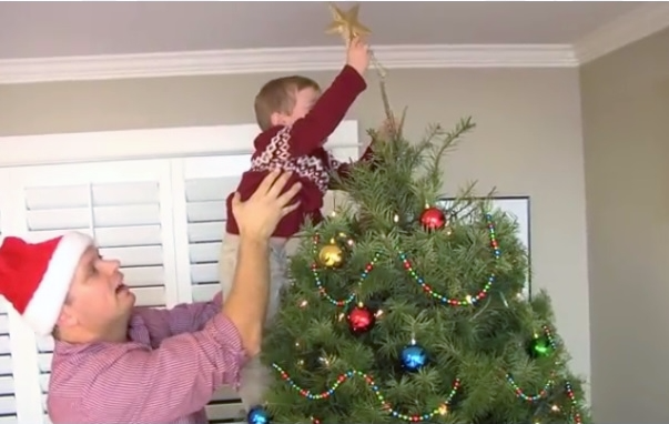 Topping the Christmas tree_Christmas Tree Promotion Board video scene