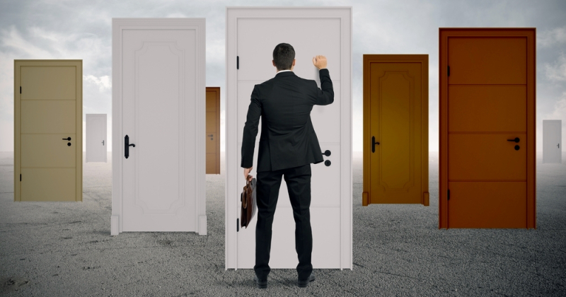 businessman knocking on door
