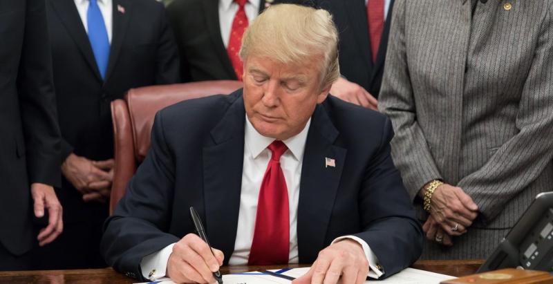 Donald J Trump signing legislation; WhiteHouse.gov photo