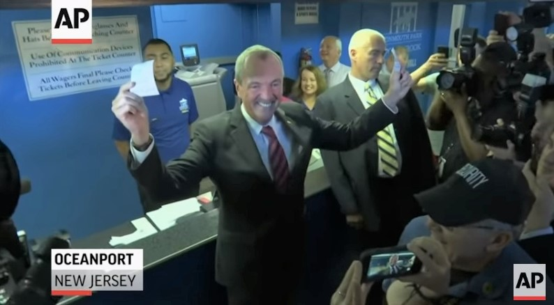 NJ Gov Phil Murphy places first legal sports bet June 14 2018 AP video screenshot