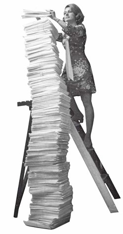 Stack of documents accessed by woman on a ladder