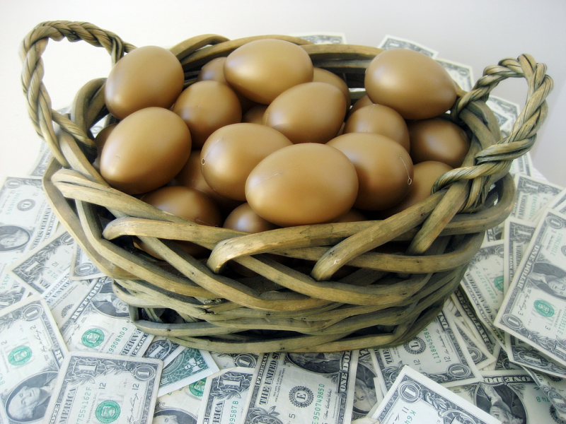Basket full of golden eggs sitting on dollar bills_Flickr 401k2012