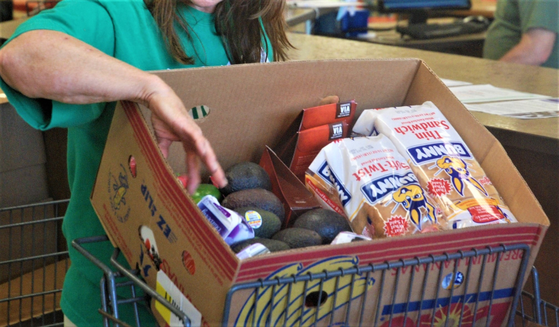 Checking out food bank offerings_Michael Losch-KOMUnews via Flickr CC-cropped