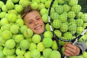Kid having fun at tennis camp