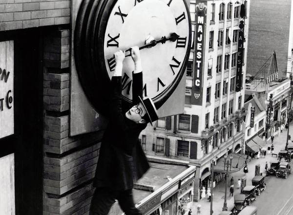 Hanging on for more time_Harold Lloyd classic movie scene