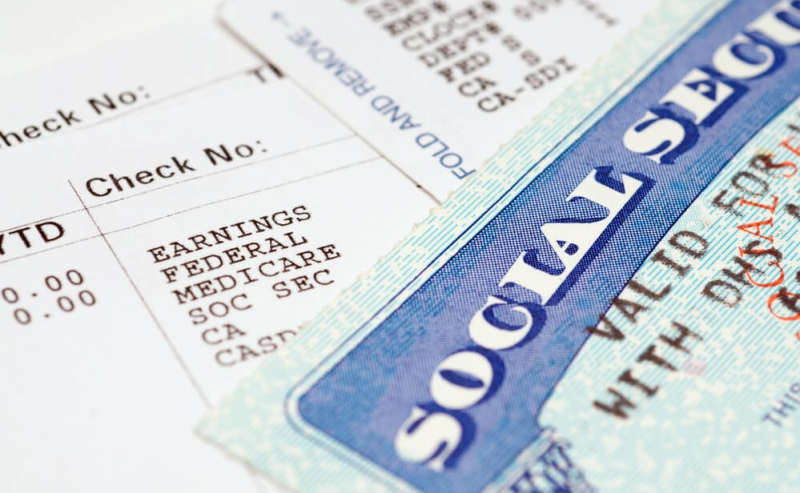 Pay stub showing Social Security Medicare FICA taxes SS card