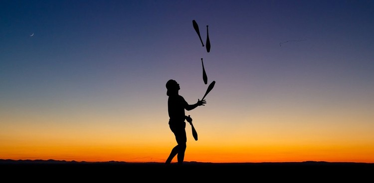 Juggling silhouette at sunset