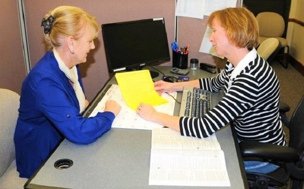 Tax preparer helping a client_US Army photo_resized
