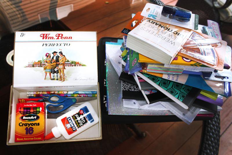 Cigar box full of school supplies