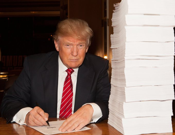Donald Trump signing tax form February 2016 via Twitter