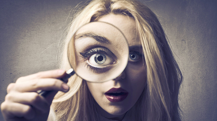 Taking a closer look_woman magnifying glass big eye