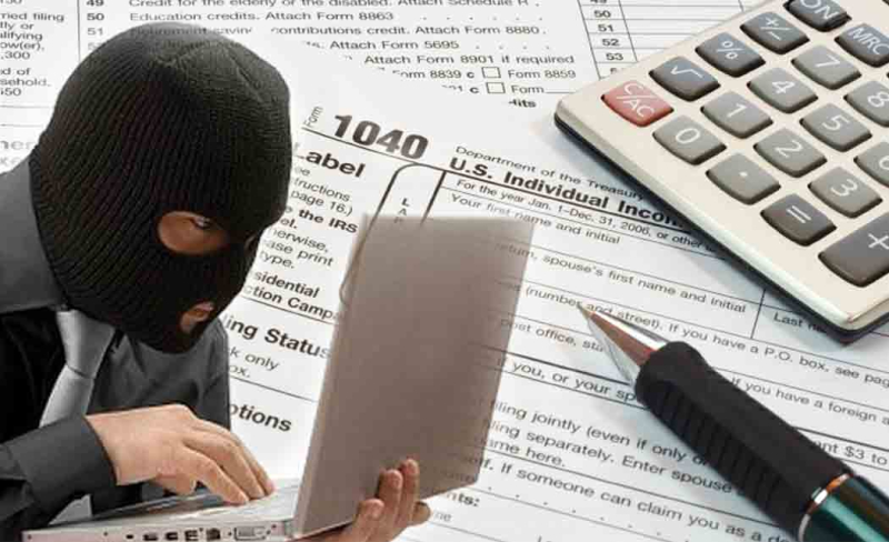 Tax identity theft masked hacker tax forms