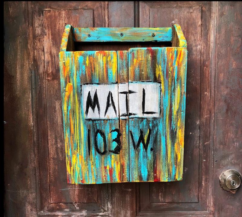 Multi-coloured-wooden-mailbox-on-door_Carlos-Cuadros_Pexels-cropped