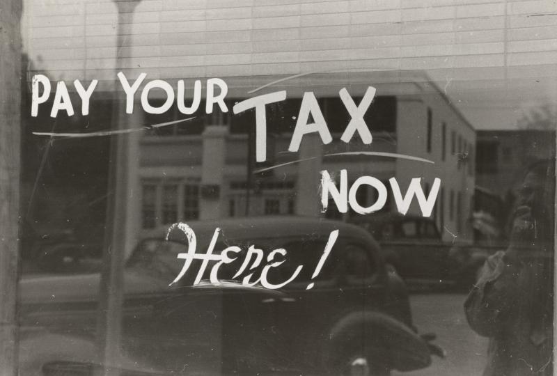 Pay tax now painted window_NY PublicLibrary 1939_ Unsplash-kAJLRQwt5yY