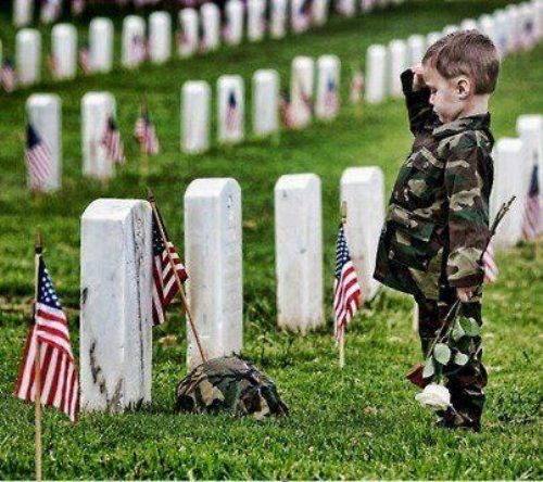 Boy saluting at military gravesite_Chive