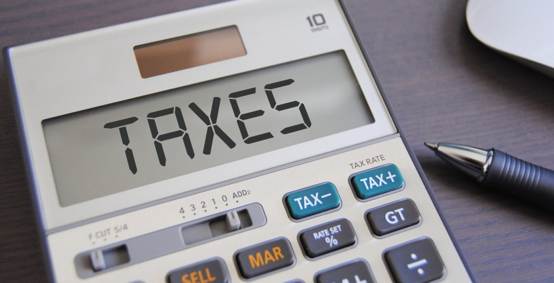Taxes spelled on calculator_GotCredit-Flickr CC